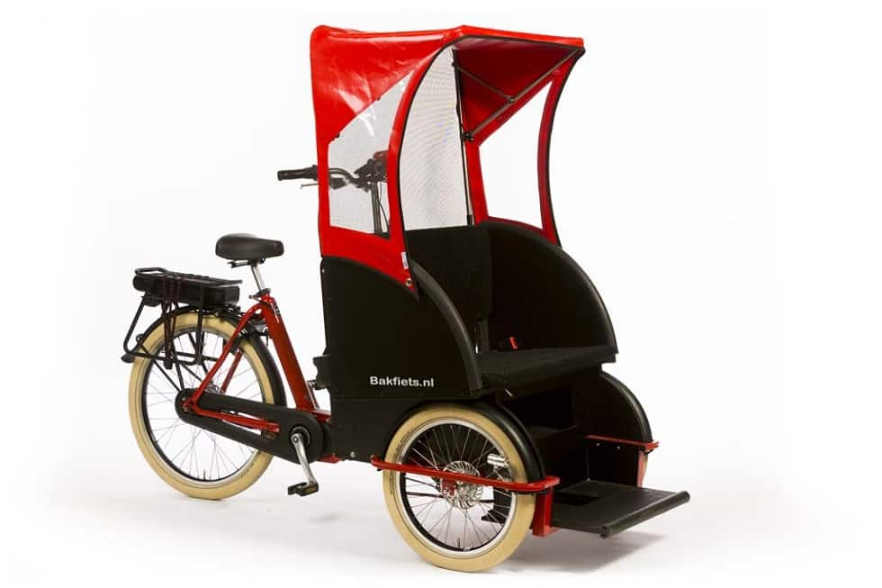 bakfiets taxi shown with sun canopy in red