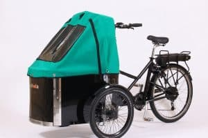 nihola cargo bike shown with green canopy fitted