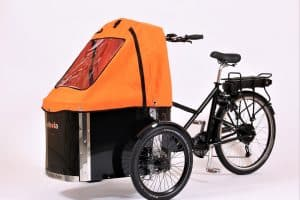 nihola cargo bike shown with orange canopy fitted