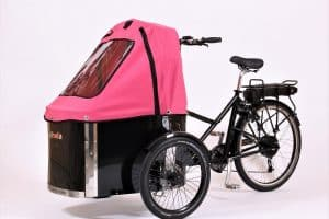 nihola cargo bike shown with pink canopy fitted