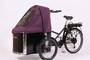 nihola cargo bike shown with purple canopy fitted