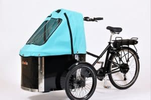 nihola cargo bike shown with turquoise canopy fitted