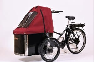 nihola cargo bike shown with wine red canopy fitted