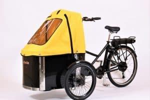 nihola rehab cargo bike shown with yellow canopy